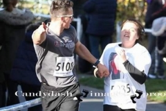 Dan urges Chloe to the finish line of the Hadleigh 5 miler