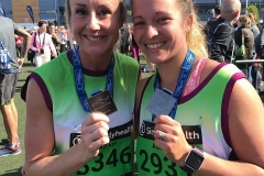 Sarah and Adele with their half marathon medals